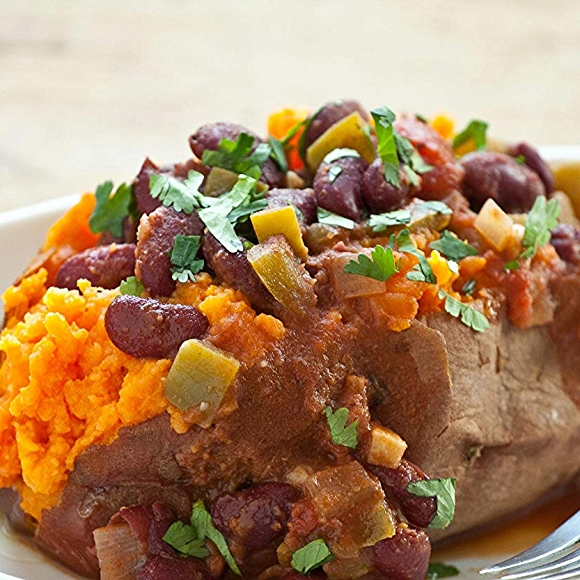Baked sweet potato with chili and cilantro