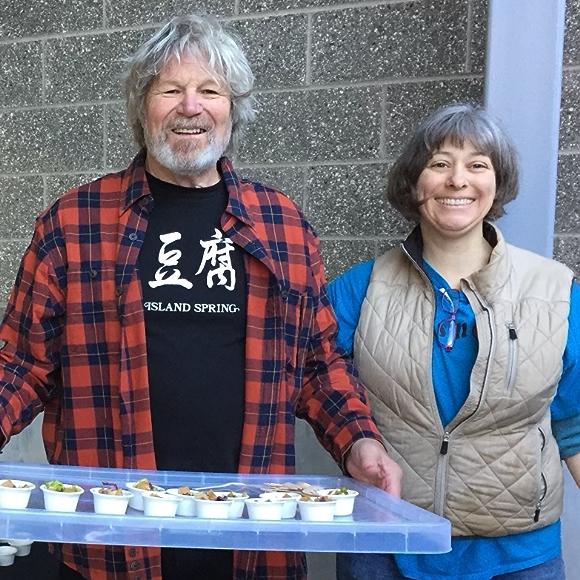 "Island Spring Organics founder W.M. ""Luke"" Lukoski holding product samples"