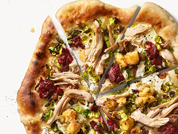 Pizza topped with Brussels Sprouts, Cranberries and Turkey