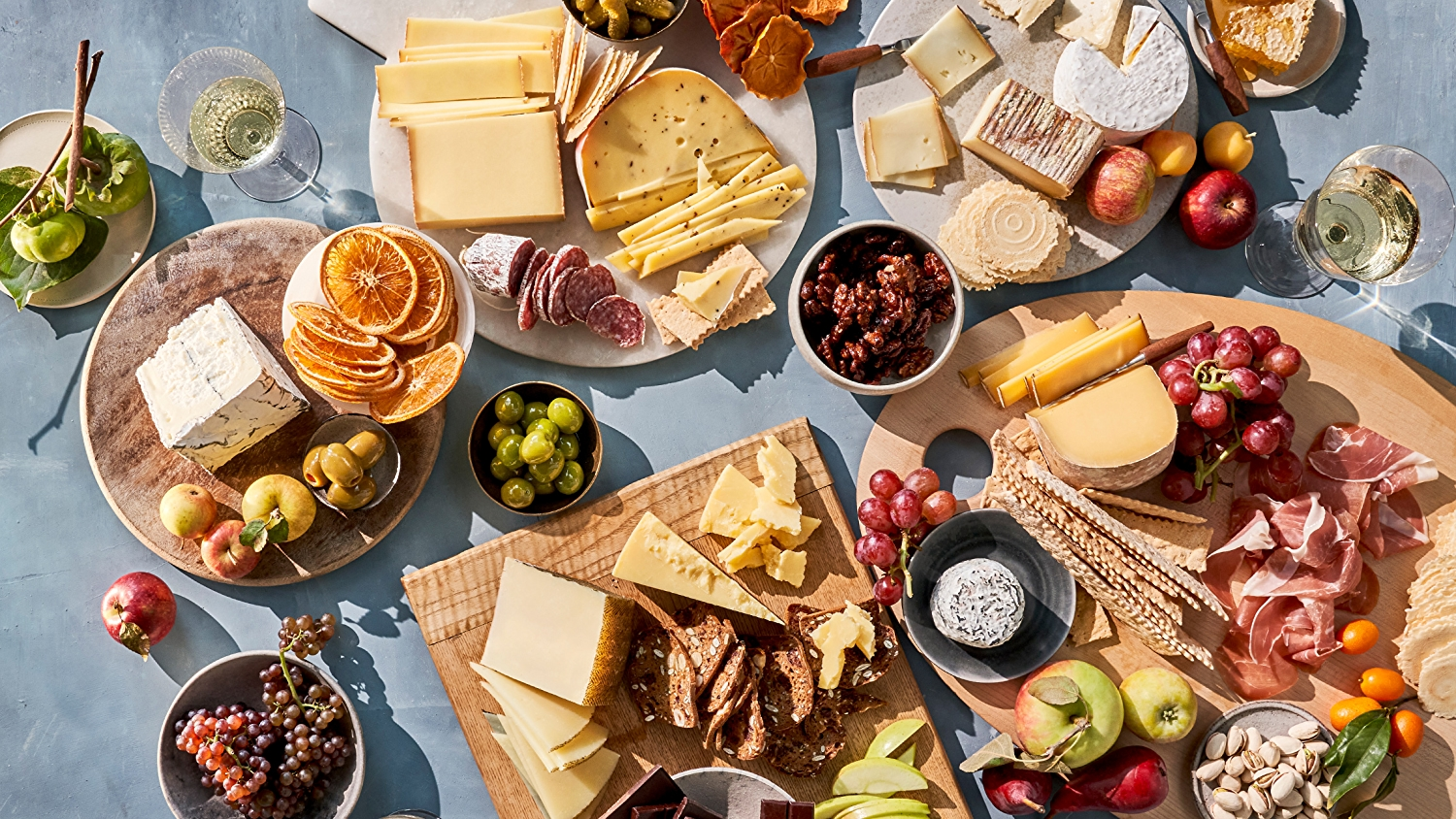 Holiday cheese board with accoutrements and wines