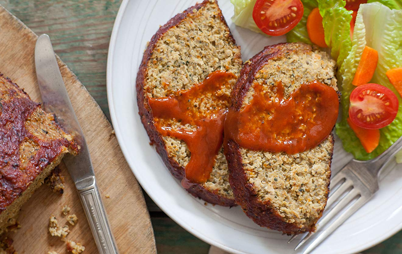 Overhead shot of sliced quinoa-turkey meatloaf recipe with ketchup on plate