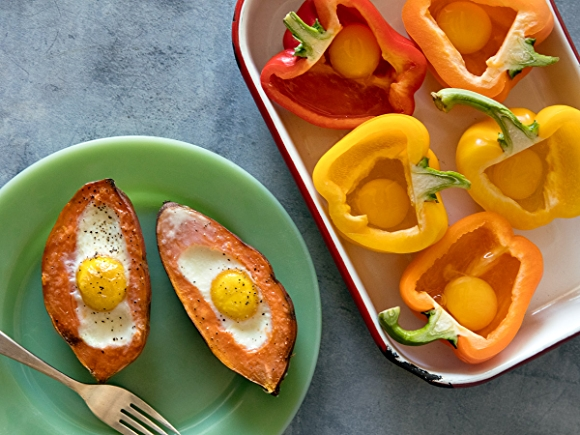 Eggs cooked inside sliced bell peppers and sweet potatoes.