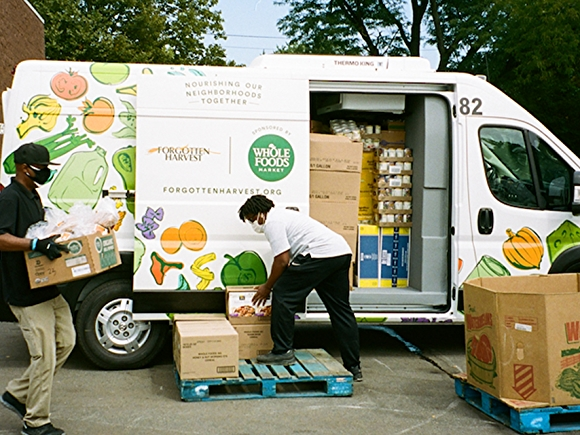 Team members loading food donation van