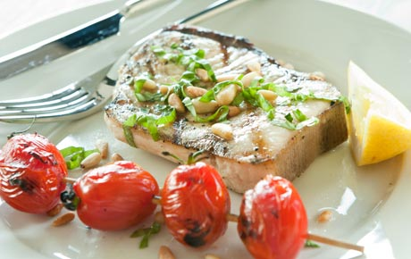 Grilled Swordfish Steaks with Tomatoes and Pine Nuts