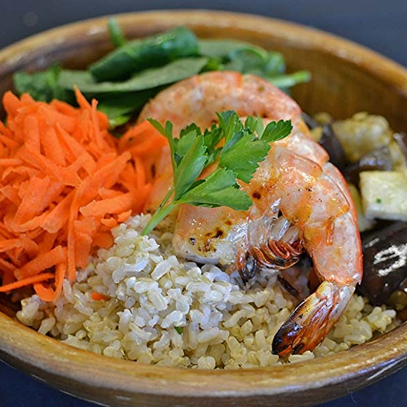 Delhi Express bowl with brown rice, roasted eggplant, spinach, carrots, grilled shrimp.