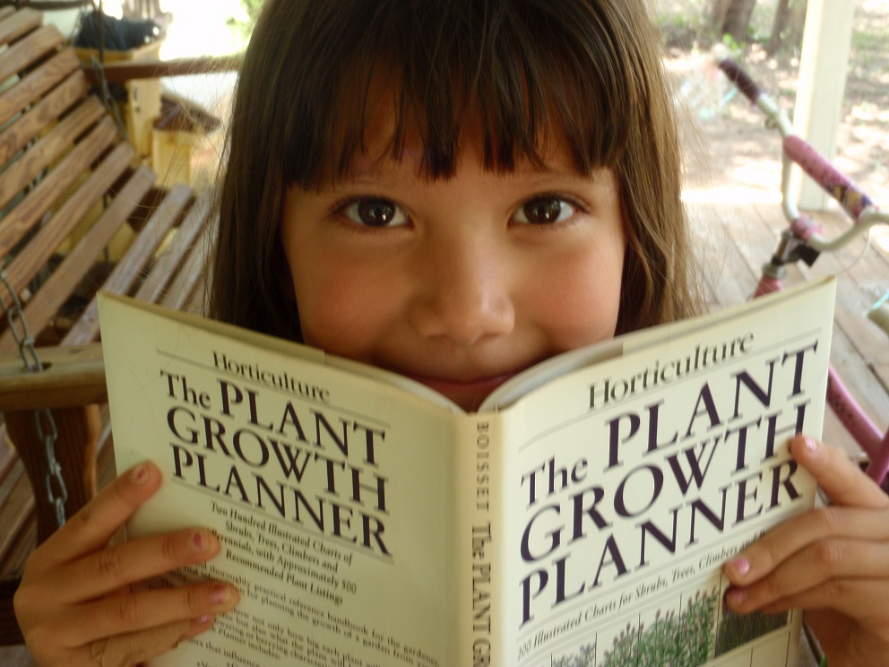 Girl with Gardening Book | Image by Cecilia Nasti