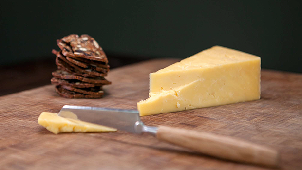 Cheddar Cheese, Crackers and a Cheese Knife