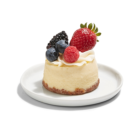 cheesecake topped with fruit on plate