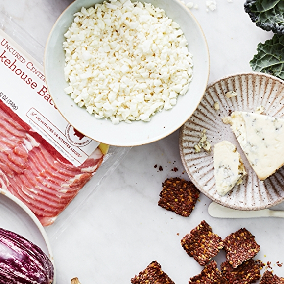 image of keto items including bacon, blue cheese, crackers and greens.