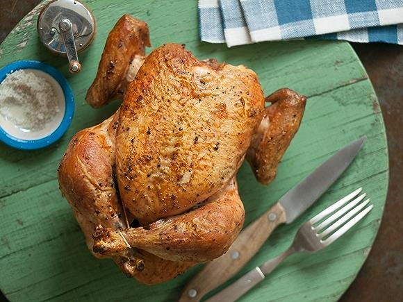 Whole roast chicken on plate