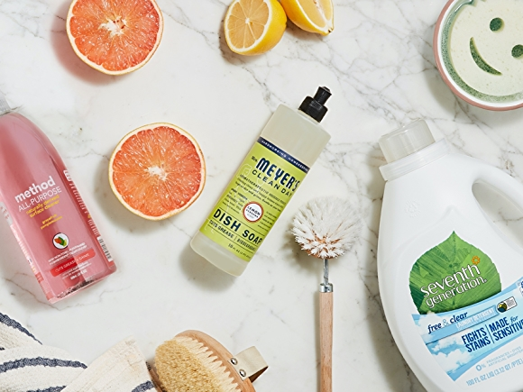 various household cleaning products on white surface