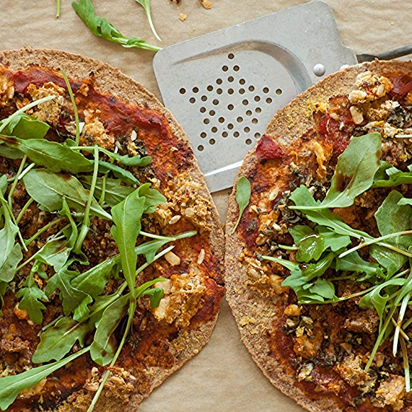Overhead shot of baked pizza top with arugula.