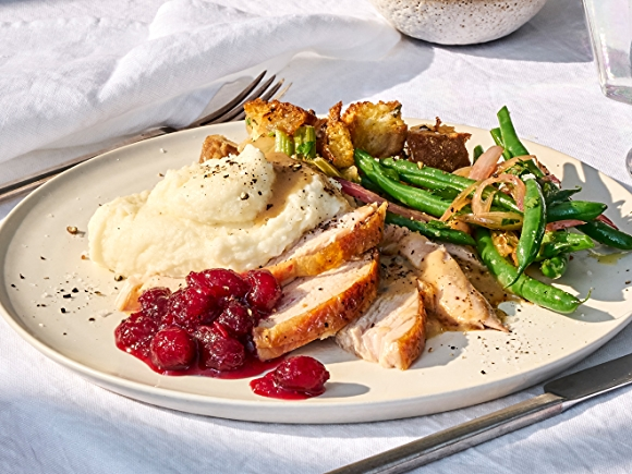 Thanksgiving Dinner Plate with Turkey and Side Dishes