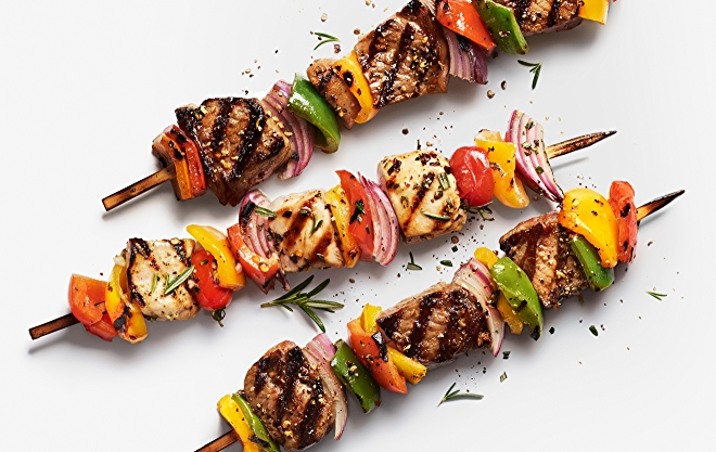 Image of chicken kabobs on white background