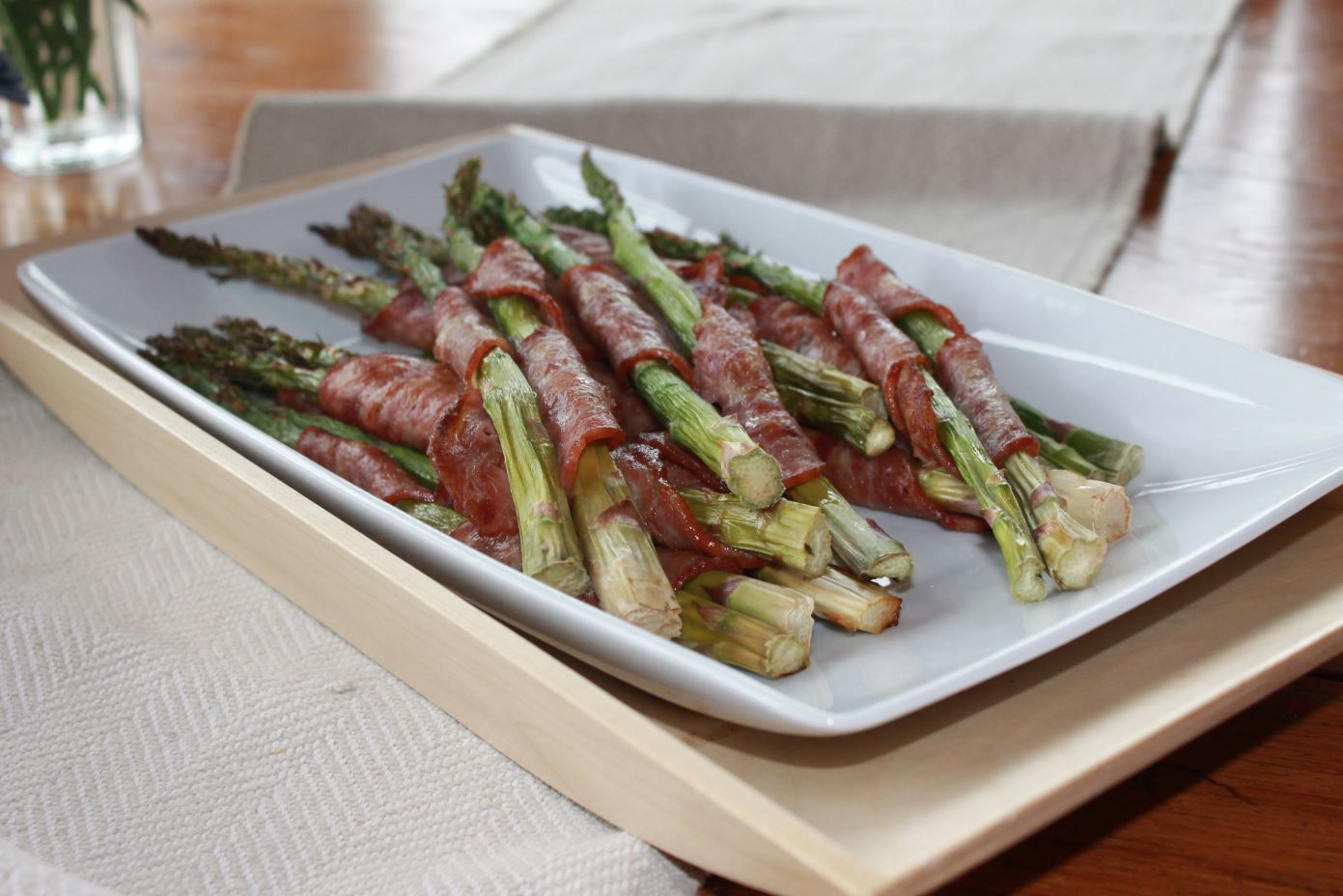 Wellshire Pork Shoulder Square Cut Uncured Bacon wrapped around asparagus spears.