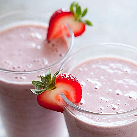 Image of strawberry almond butter smoothie recipe garnished with strawberry