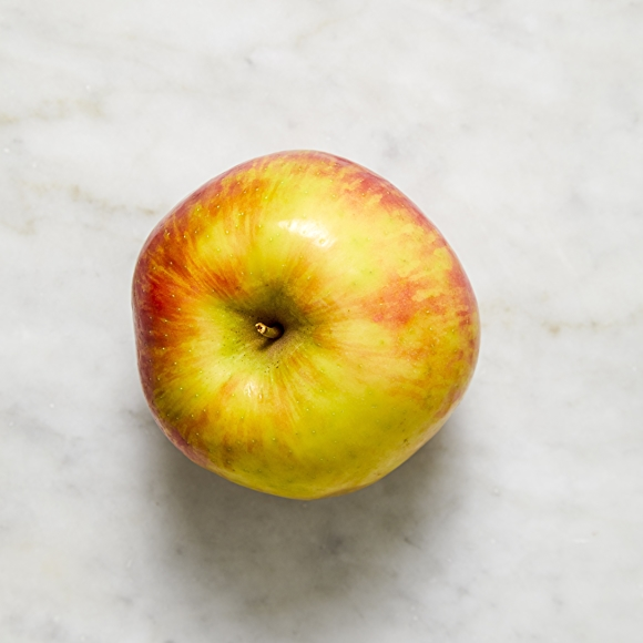 Photo of honeycrisp apple on white surface