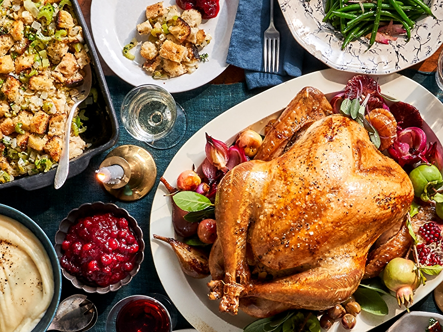 Thanksgiving Table with Turkey, Sides and Wine