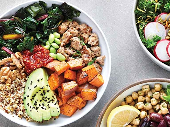 Overhead shot of 3 bowls from left to right:  Turkey, Chard and Sweet Potato Grain Bowl, Sweet Potato Noodle Bowl with Halibut, and Mediterranean Grain Bowl