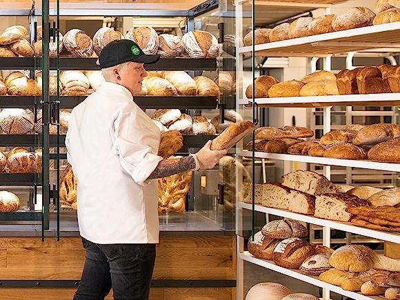 WFM Team Member stocking the shelves in the bakery department