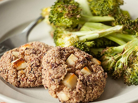 """Plate of """"Cheesy"""" Baked quinoa cakes with roasted broccoli recipe."""