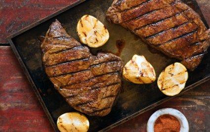 Berbere-Rubbed Rib-Eye Steaks with Grilled Lemon