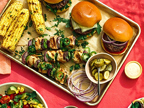 image of grilled items including vegetables and burgers.
