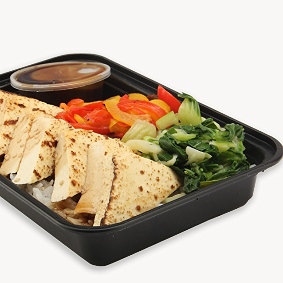 Prepared meal in a container, tofu and vegetables