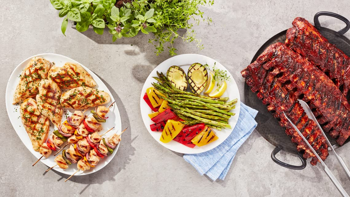 Image of grilled meats and vegetables including chicken, peppers, avocado, asparagus and ribs.