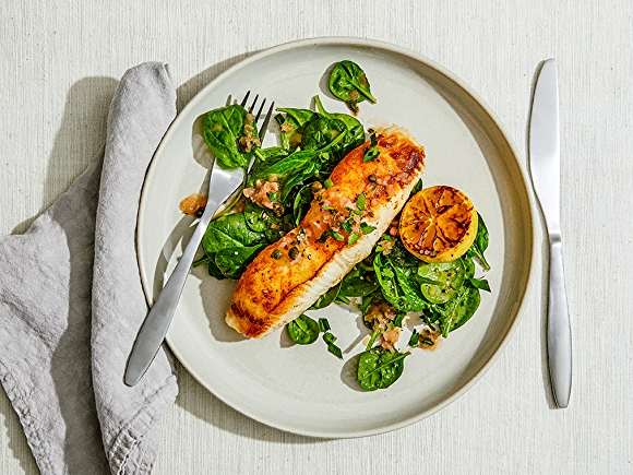 pan-seared sea bass on plate with spinach