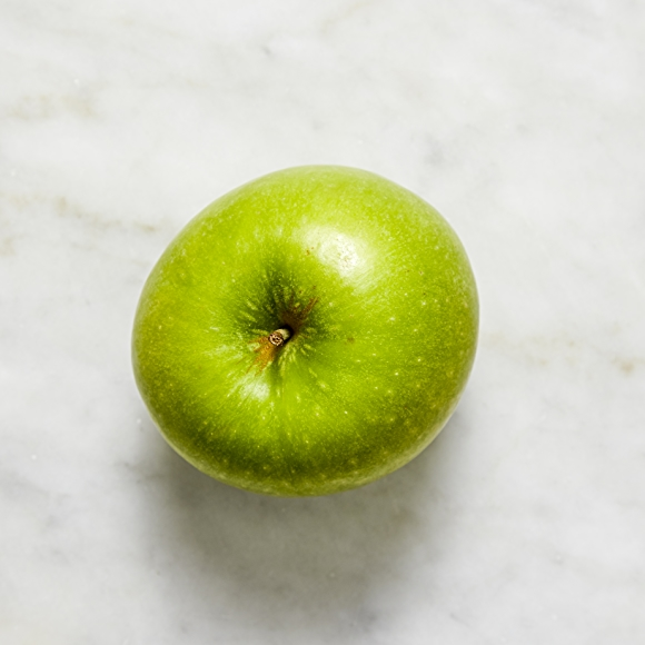 Photo of granny smith apple on white background