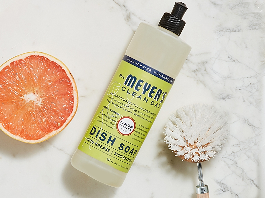 Mrs Meyer's Clean Day dish soap on white background with green leaf