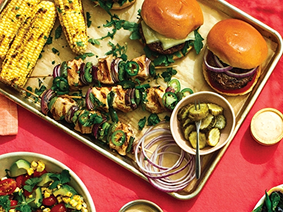 Image of lighter grilling items, corn, kabobs and grilling.