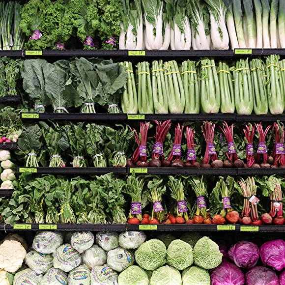 organic green vegetables in whole foods market produce department