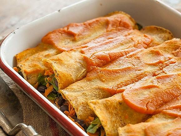 Image of dish with baked black bean and sweet potato enchiladas recipe.
