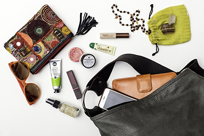 Makeup and skincare in purse