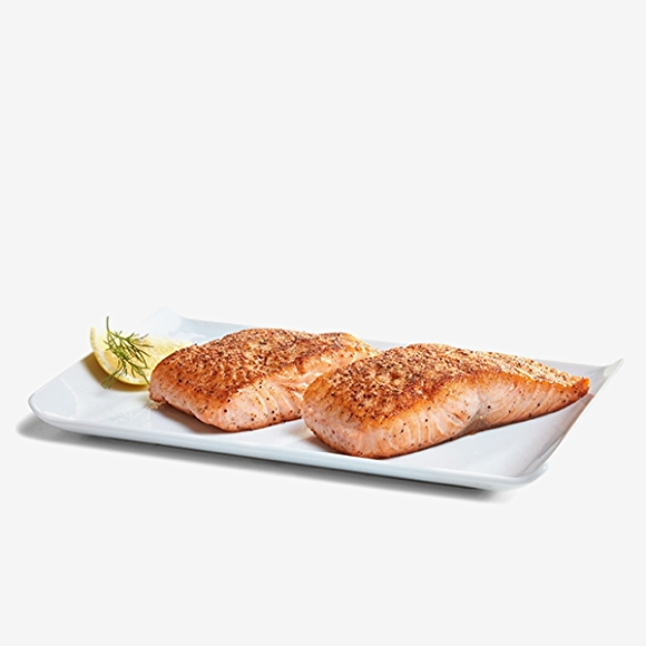 Image of cooked salmon on white plate