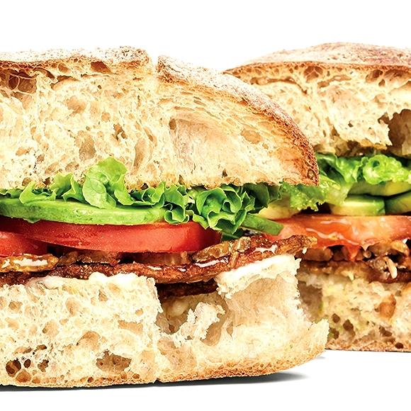 Sandwich with tempeh, tomato, lettuce, avocado