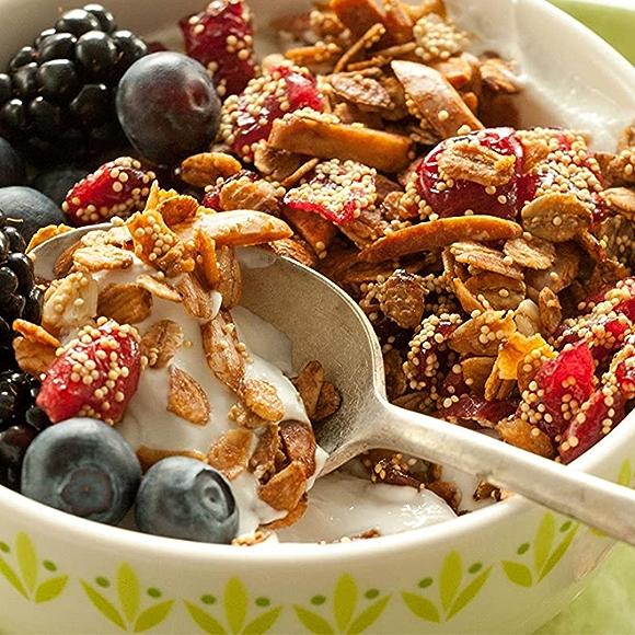 Nondairy yogurt and vegan granola with berries