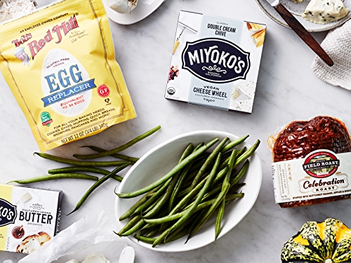 Vegan grocery items including egg replacer, miyoko's butter and vegetables.