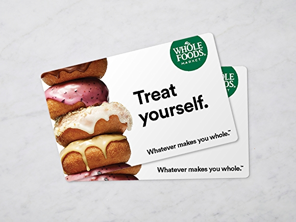 Whole Foods Market gift card on marble background.
