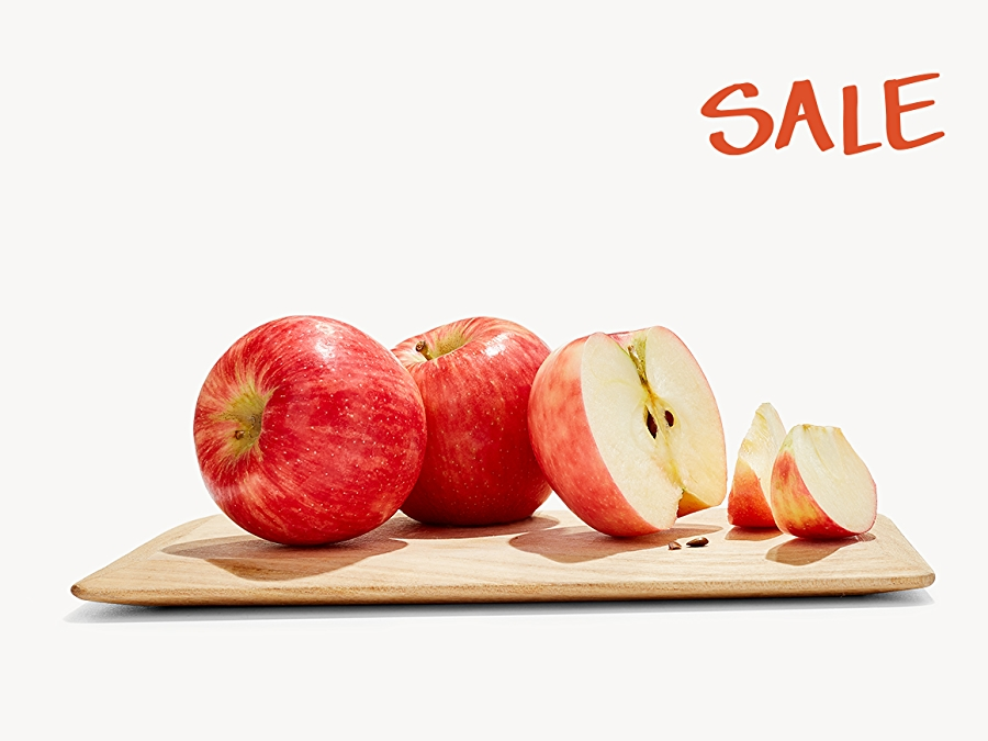 Honey Crisp Apples on a cutting board, Sale logo in red in upper right corner