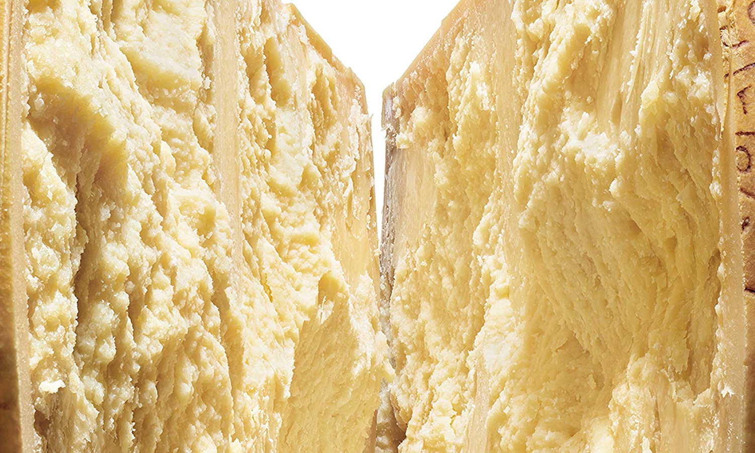 Close up image of a wheel of Parmigiano-Reggiano