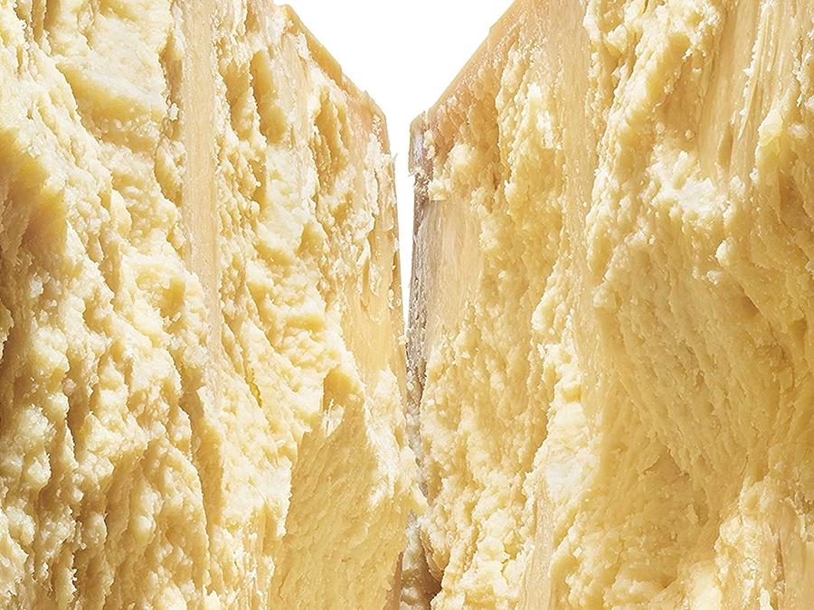 Close up image of a wheel of Parmigiano-Reggiano