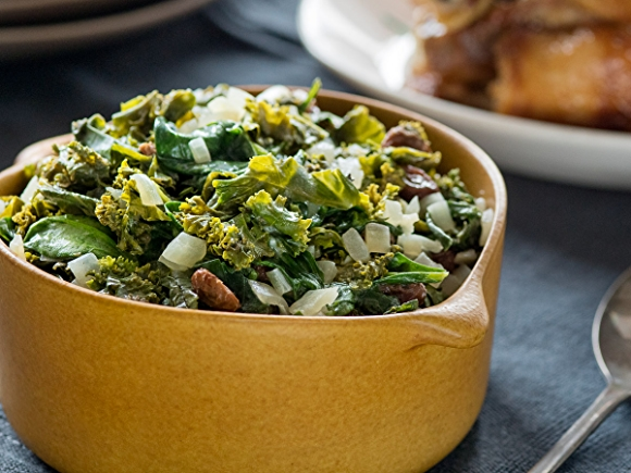 Coconut creamed spinach and kale greens in bowl.