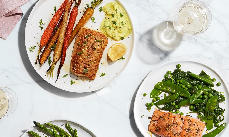 Plated seafood dinners shot overhead