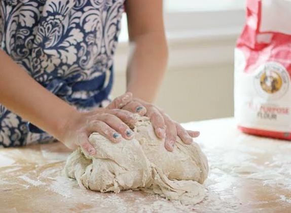 Child making bread
