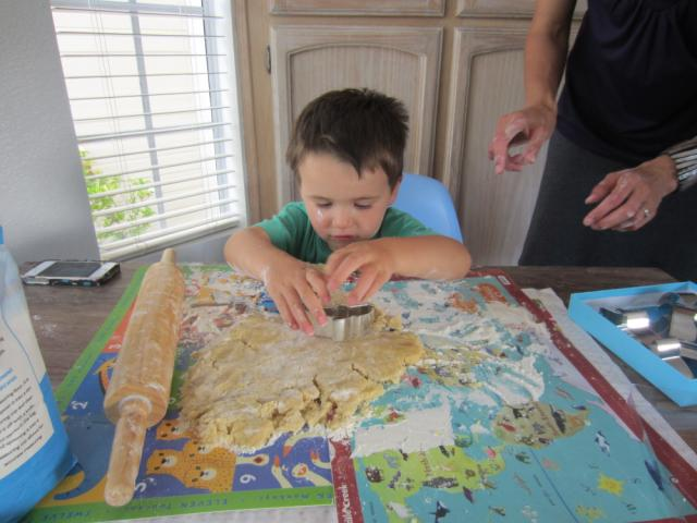 Kid Cutting Out Cookie Dough