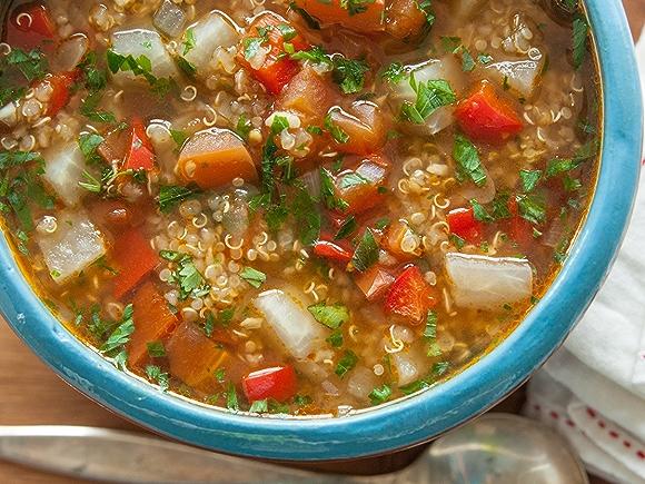 Image of Vegetable quninoa soup shot overhead