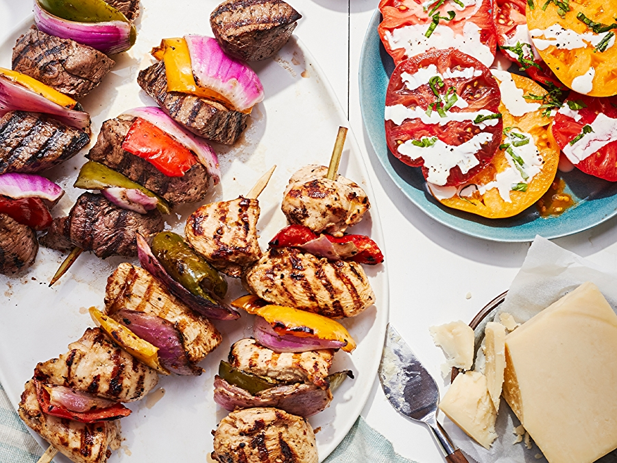 Kabobs and tomato salad